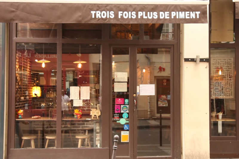 This is a picture of the exterior at 3 fois plus piment, which is a nice restaurant in Paris.