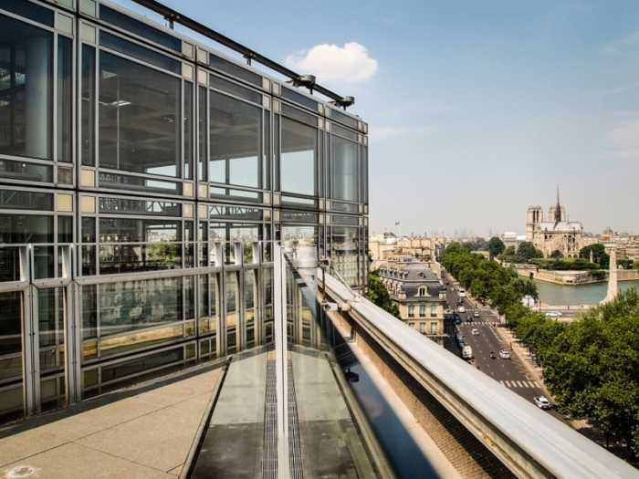 This is a picture of a terrace in Paris where we can see Notre Dame.