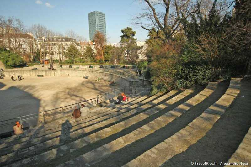 This is a picture of les arênes de luteces, which is a really nice place to visit in Paris. And people are sitting, mainly couples.