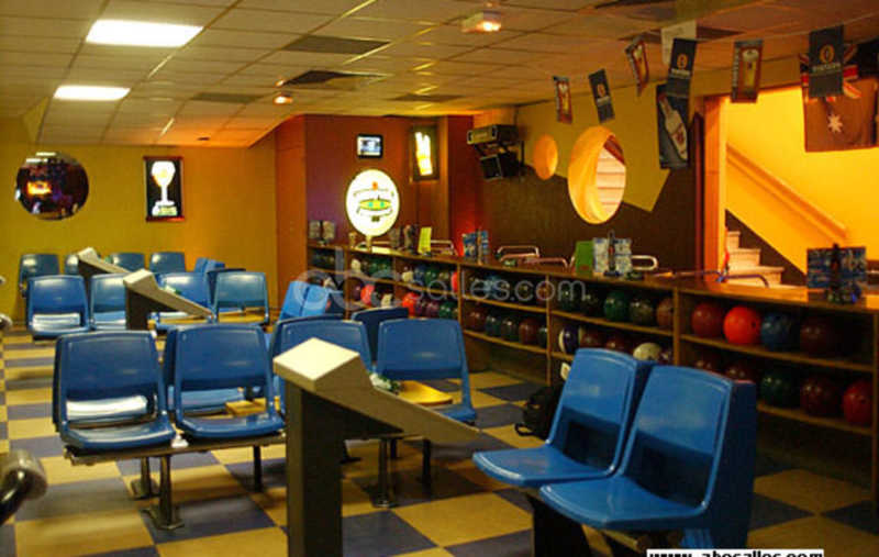 This is a picture of a bowling room in Paris.
