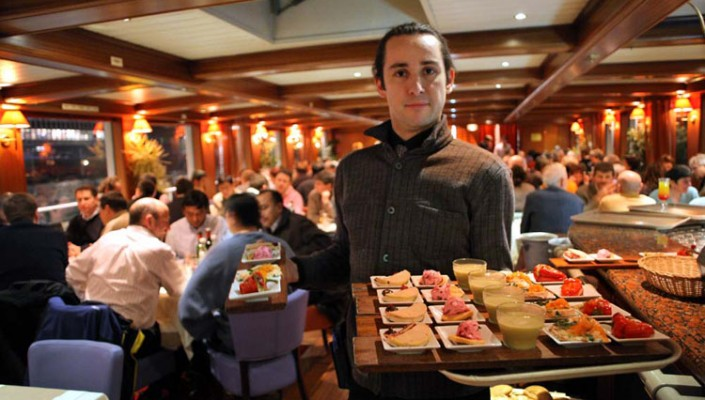 This is a picture of the waiter on a peniche, which is a nice restaurant in paris.