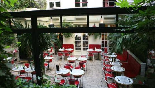 This is a picture of the terrace of the Hotel Amour, which is a really nice restaurant in Paris.