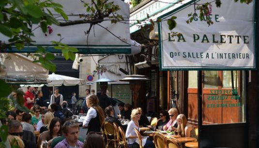 People are enjoying a romantic terrace in Paris, called la Palette