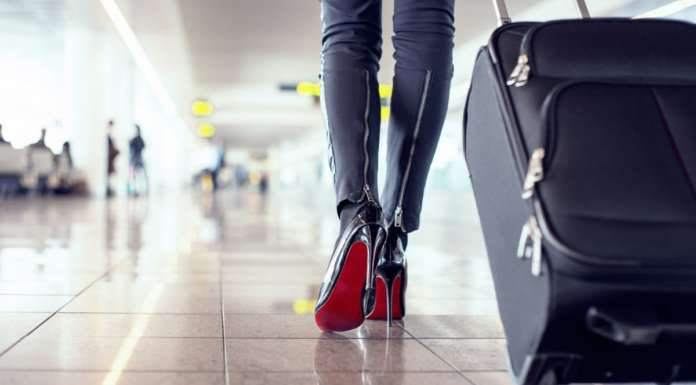 Picture of a woman with a luggage.
